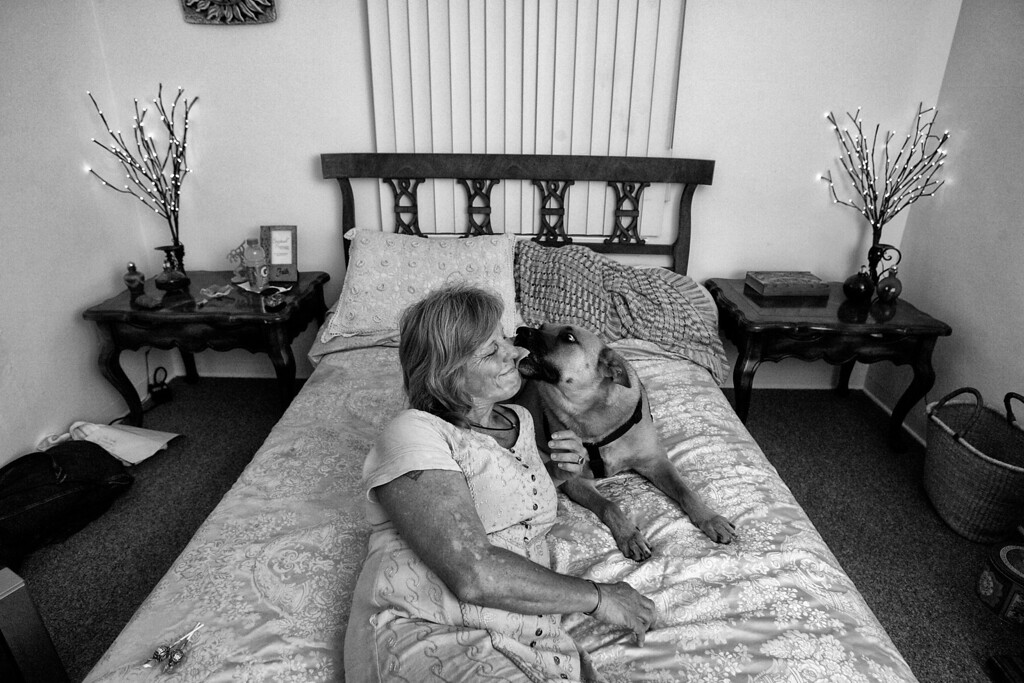 . After years on the streets Dorothy and her dog Gunner share a moment in her new home, a one-bedroom cottage residence in Pasadena, California.  (Photos by Sarah Reingewirtz / Pasadena Star-News)