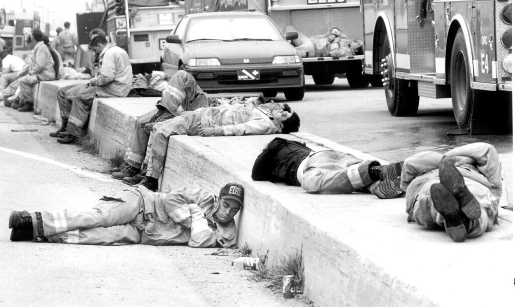 . Los Angeles County firefighters catch some sleep along Pacific Coast Highway after spending the night on the fire lines on November 3, 1993.   Los Angeles Daily News file photo