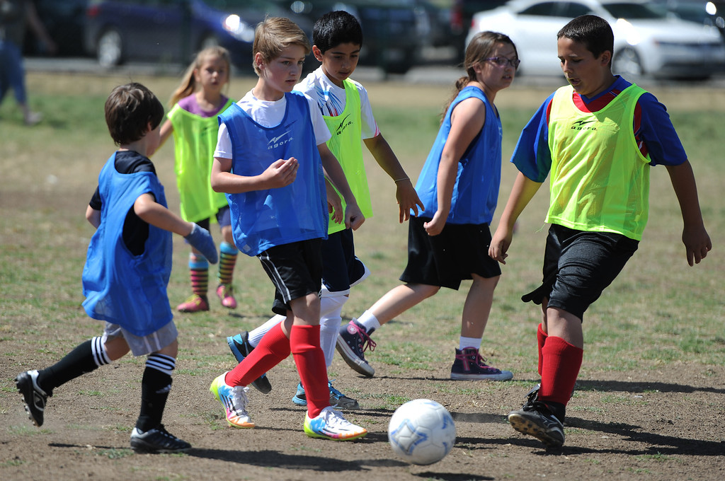""". In honor of the AYSO\'s 50th anniversary as the nation�s most active and open youth soccer organization, kids at Balboa Park in Encino will join efforts around the country Saturday--over 500,000 players,125,000 volunteers,100 community-based events and a national soccer festival--to set a world record for the \""""largest pickup game on Earth.\"""" Encino, CA. 5/3/2014(Photo by John McCoy / Los Angeles Daily News)"""