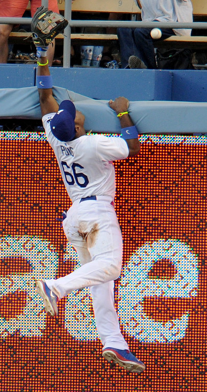 . Dodgers Yasiel Puig jumps up but can not come down with a Home run ball hit by NY Yankees Lyle Overbay in the 2nd inning in a game at Dodger Stadium in Los Angeles, CA. 7/30/2013(John McCoy/LA Daily News)