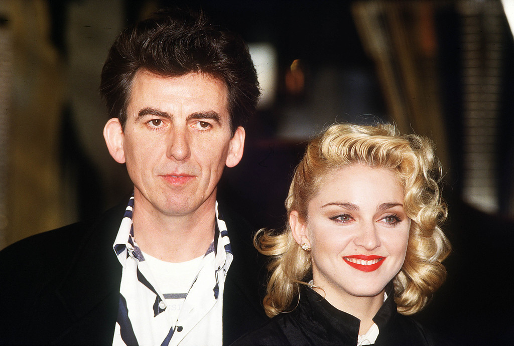 ". U.S. pop singer and actress Madonna and former Beatles guitarist George Harrison publicise the movie ""Shanghai Surprise\"" in London in March 1986. Harrison has produced the movie in which Madonna stars. (AP Photo/Peter Kemp)"