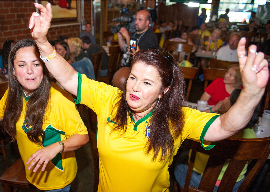 . Daphne Balcazar of Yorba Linda and Moncia Souza of Yorba Linda dance to the Brazilian music as soccer fans showed up at Gauchos Village, a Brazilian style restaurant in Glendale to party and watch live television broadcast  of World Cup action between Brazil and Croatia in the World Cup Thursday, June 12, 2014.(Photo by Walt Mancini/Pasadena Star-News)