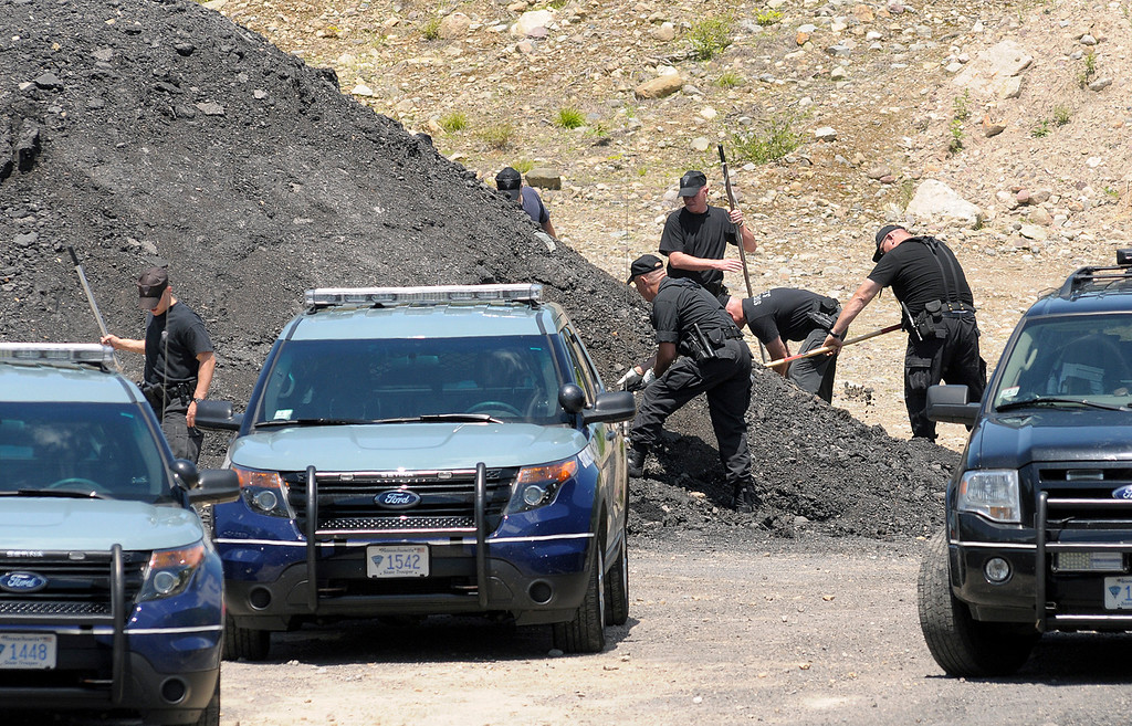 . Massachusetts State Police dig for evidence Thursday, June 20, 2013, at the sight in an industrial park in North Attleborough, Mass., where the body of Odin Lloyd, of Boston, was found earlier this week. New England Patriots tight end Aaron Hernandez had a connection Lloyd, but family and officials were mum on the nature of their relationship Thursday, two days after police visited Hernandez\' home. (AP Photo/The Sun Chronicle, Mark Stockwell)