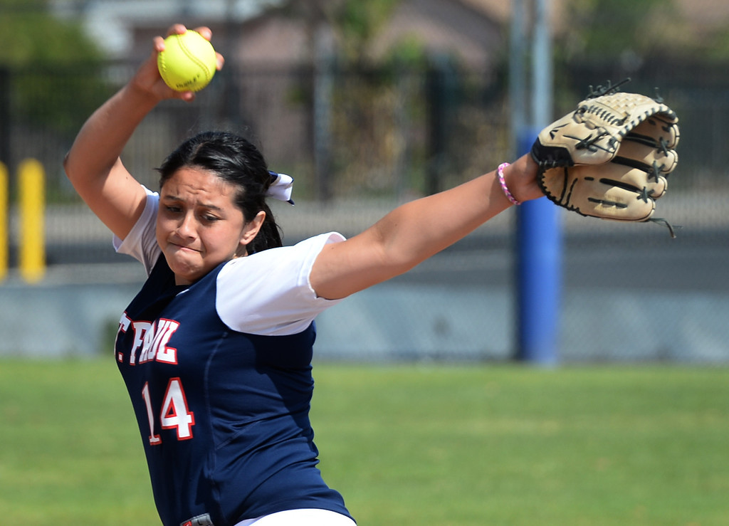 . St. Paul\'s Koreen Orozco (#14) makes a pitch as they play Bishop Amat in their Del Rey League girls softball game at York Field in Whittier on Thursday March 27, 2014. St. Paul defeated Bishop Amat 7-5. (Staff Photo by Keith Durflinger/Whittier Daily News)