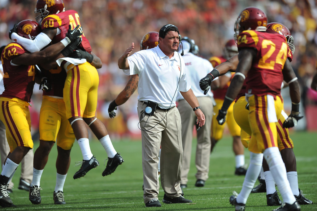 . USC head coach Ed Orgeron congratulates his team after a fumble recovery, Saturday, October 26, 2013, at the L.A. Memorial Coliseum. (Michael Owen Baker/L.A. Daily News)