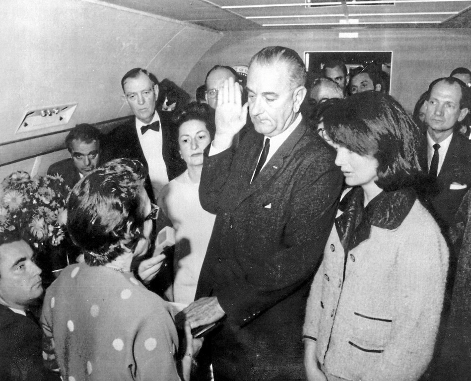 . 50th Anniversary of John F. Kennedy assassination- Lyndon B. Johnson is sworn in as president as Jacqueline Kennedy stands at his side.