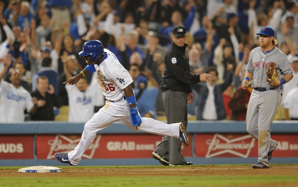 . Yasiel Puig rounds 3rd after being driven in on a Adrian Gonzalez double to win the game. The Dodgers defeated the New York Mets 5-4 in 12 innings at Dodger Stadium in Los Angeles, CA. 8/13/2013(John McCoy/LA Daily News)