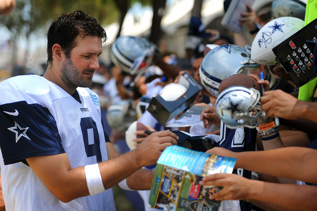 . Cowboys QB Tony Romo signs autographs after the Cowboys-Raiders practice in Oxnard, Wednesday, August 13, 2014. (Photo by Michael Owen Baker/Los Angeles Daily News)