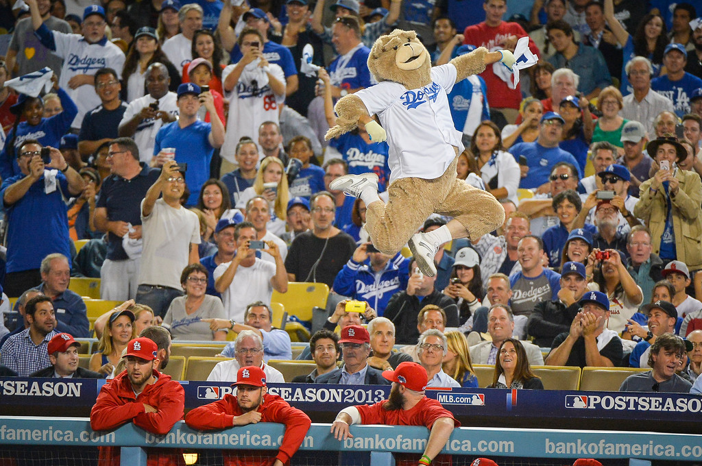 . A person dressed as a monkey dances above the Cardinals dugout during game 3 of the NLCS series at Dodger stadium Monday, October 14, 2013 ( Photo by Andy Holzman/Los Angeles Daily News )