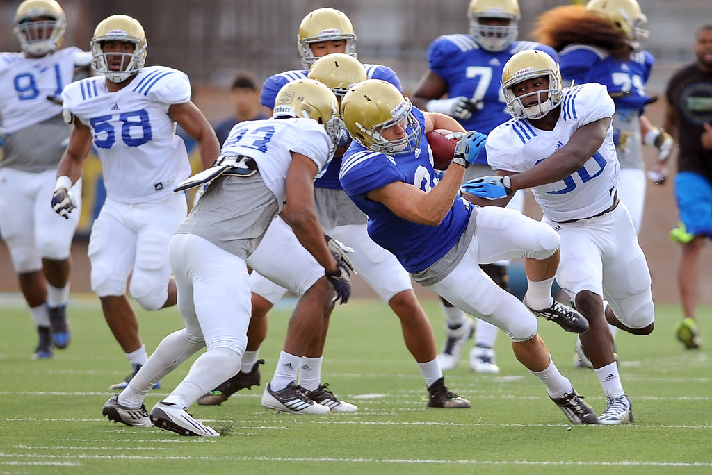 . UCLA players take the field for spring practice April 9, 2014 in Westwood, CA.(Andy Holzman/Los Angeles Daily News)