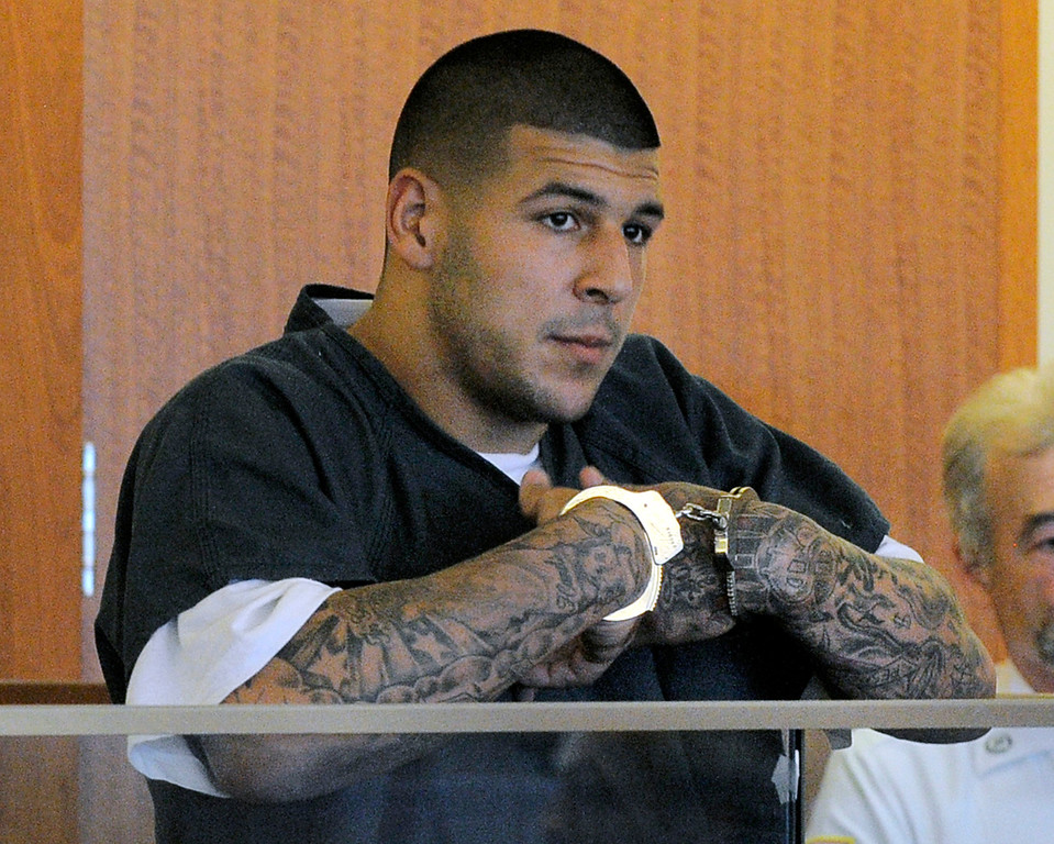 . Former New England Patriots football tight end Aaron Hernandez stands during a bail hearing in Fall River Superior Court Thursday, June 27, 2013 in Fall River, Mass. Hernandez, charged with murdering Odin Lloyd, a 27-year-old semi-pro football player, was denied bail. (AP Photo/Boston Herald, Ted Fitzgerald, Pool)