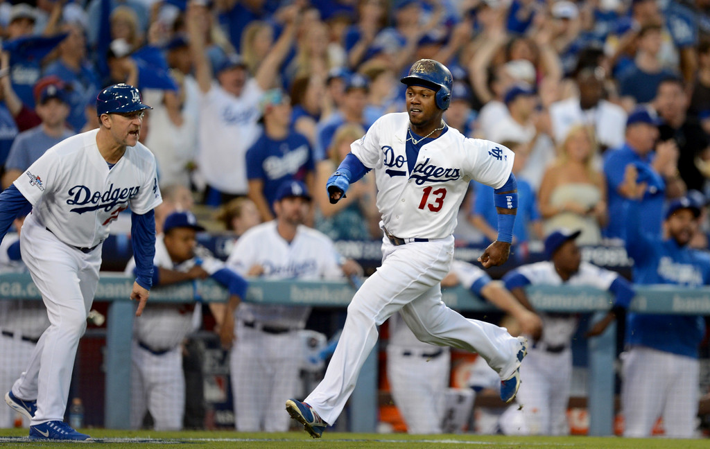 . Los Angeles Dodgers\' third base coach Tim Wallach cheers Hanley Ramirez as he brings in a run during game 3 of the NLDS at Dodger Stadium Sunday, October 6, 2013. (Photo by Hans Gutknecht/Los Angeles Daily News)
