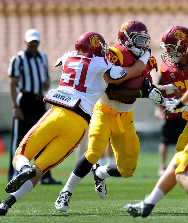 . USC LB Joel Foy wraps up FB Jahleel Pinner during their spring game, Saturday, April 19, 2014, at the Coliseum. (Photo by Michael Owen Baker/L.A. Daily News)