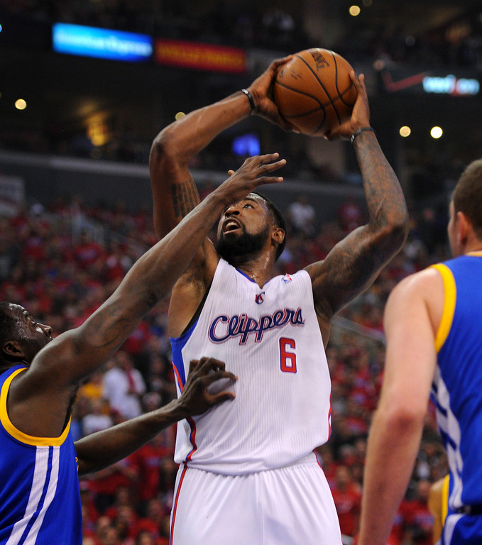 . The Clippers\' DeAndre Jordan goes to shoot over the Warriors\' Draymond Green in game seven of the Western Conference playoffs, Saturday, May 3, 2014, at Staples Center. (Photo by Michael Owen Baker/L.A. Daily News)