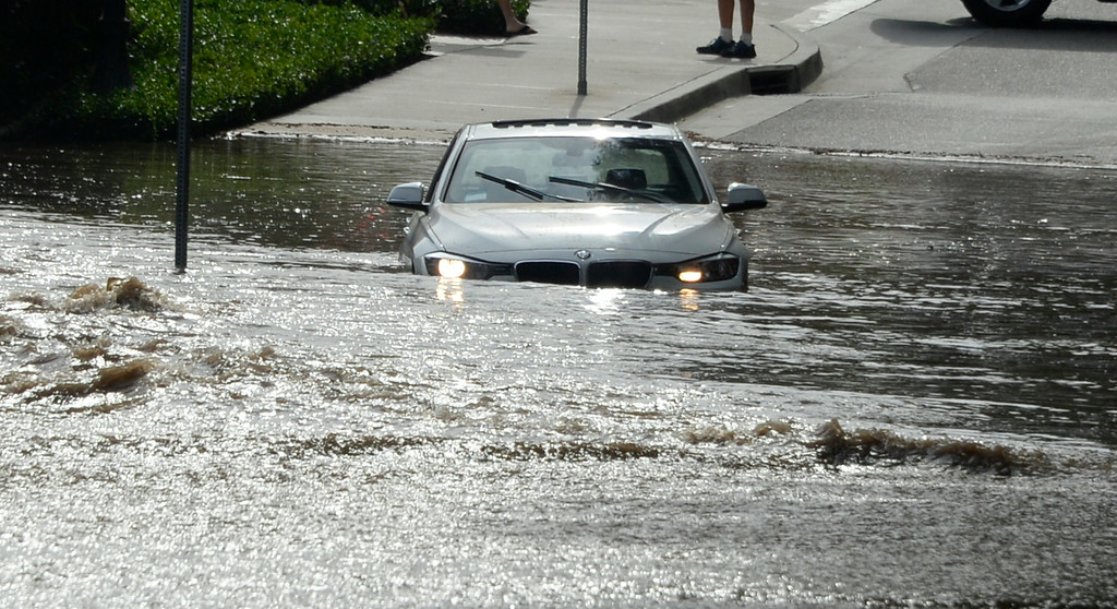 . July 29,2014. Westwood CA,  One of many cars that got stuck after a major water main break sent a geyser of water blasting through Sunset Boulevard north of the UCLA campus Tuesday, sending mud and water cascading down the street and inundating a number of vehicles as it made its way onto the campus. Photo by Gene Blevins/LA DailyNews