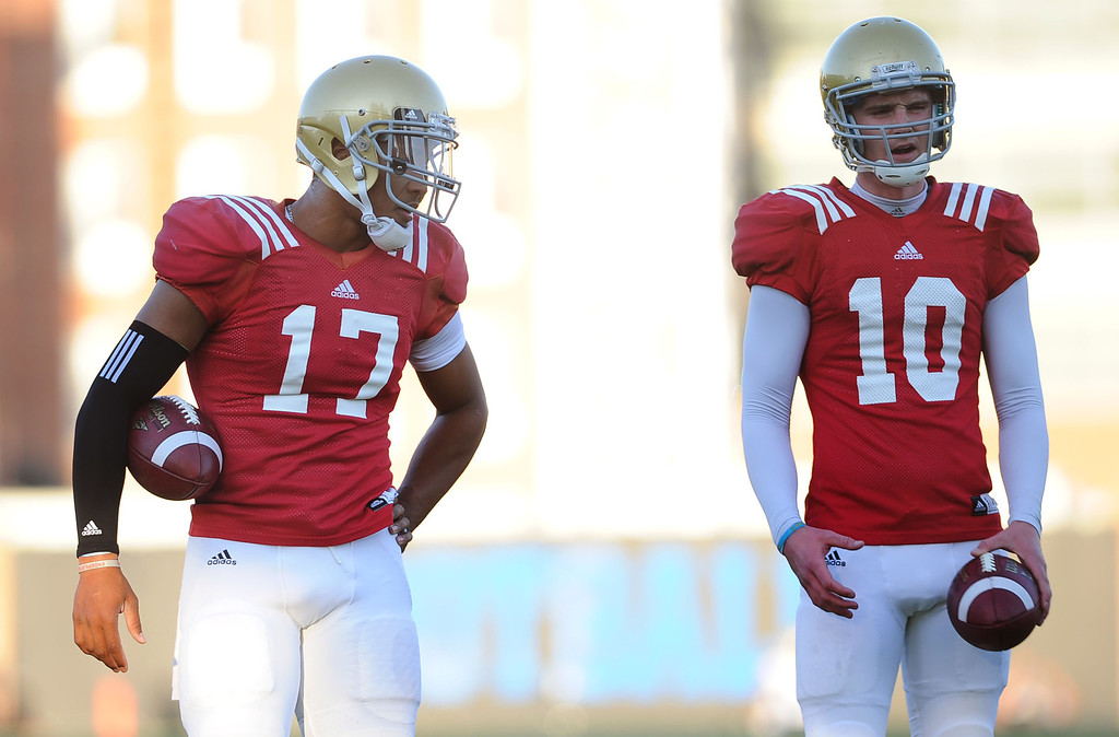 . UCLA quarterbacks Brett Hundley and Jake Hall during spring practice Monday April 7, 2014 at UCLA.(Andy Holzman/Los Angeles Daily News)