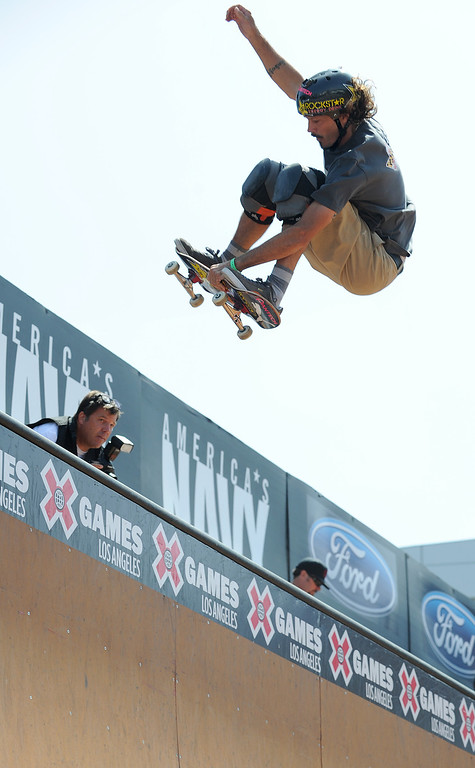. Bucky Lasek on his way to first place during the Skateboard Vert Finals at L.A. Live in Los Angeles, CA. 8/3/2013(John McCoy/LA Daily News)