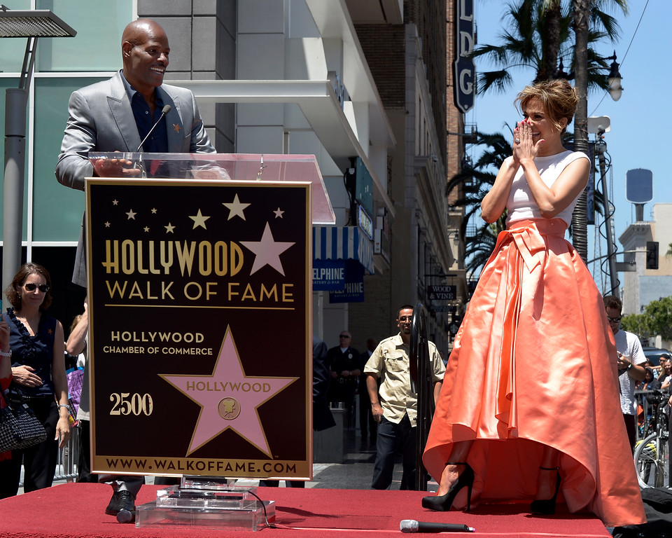 . US actress, singer Jennifer Lopez (R) laughs as US actor Keenan Ivory Wayans (L) speaks during Lopez\' star ceremony on the Hollywood Walk of Fame in Hollywood, California, USA 20 June 2013. Lopez was awarded the 2,500th star on the Hollywood Walk of Fame in the category of Recording.  EPA/PAUL BUCK
