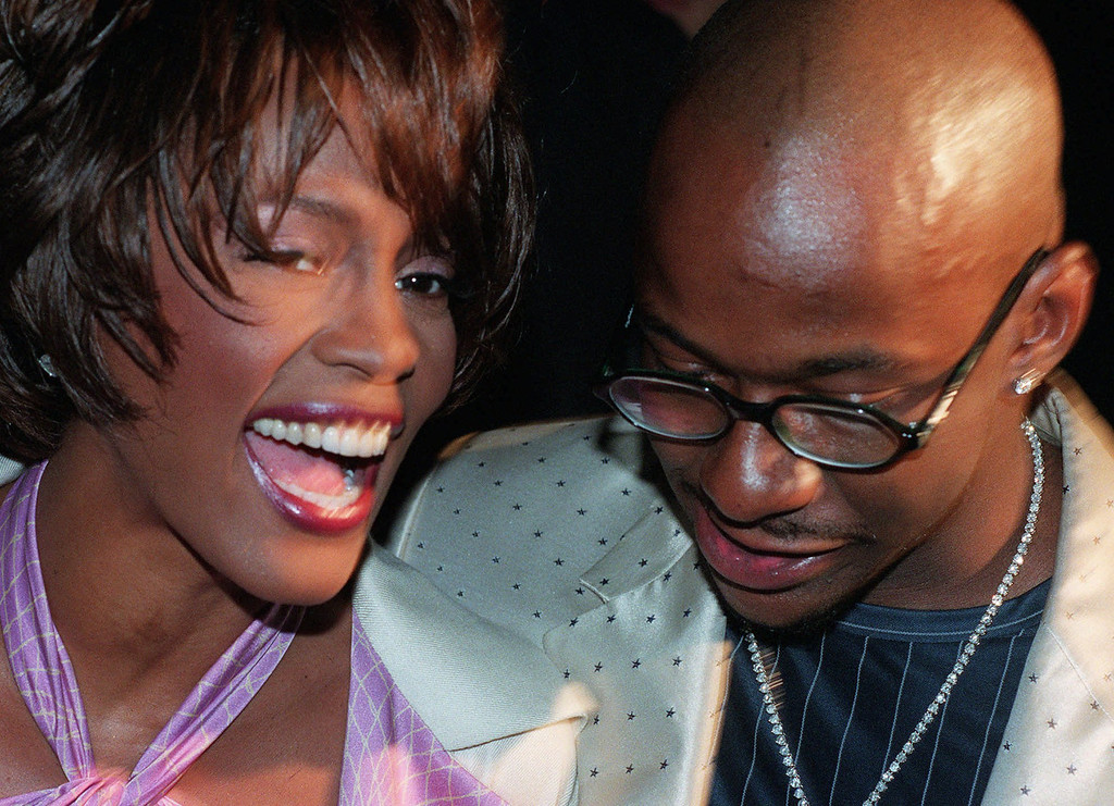 . Whitney Houston and her husband Bobby Brown arrive for the Versace Fall 1998 fashion show in New York Saturday, March 28, 1998. (AP Photo/Mark Lennihan)