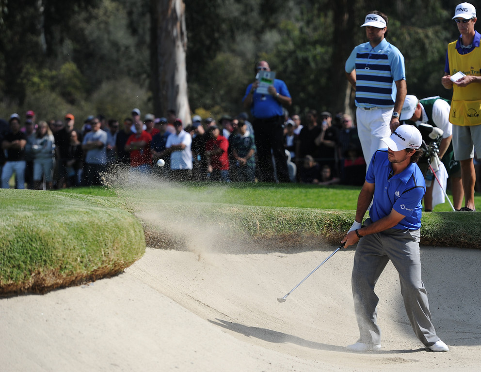 . Brian Harman hits out of the bunker behind the 10th hole. Bubba Watson won the 2014 Northern Trust Open. Pacific Palisades, CA. February 16, 2014 (Photo by John McCoy / Los Angeles Daily News)
