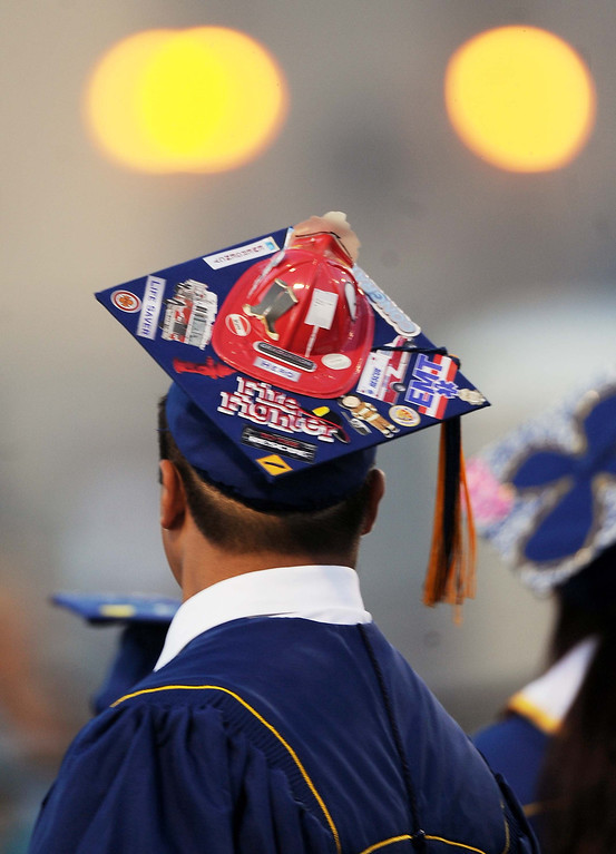 . Yucaipa High School graduates the Class of 2013 Wednesday June 12, 2013 at Yucaipa\'s Thunderbird Stadium. (LaFonzo Carter/Daily Bulletin)