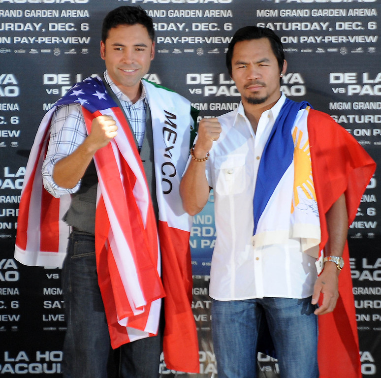 . Oscar De La Hoya(L) and Manny Pacquiao pose together during a press conference for their upcoming fight  in Las Vegas on December 6th at the MGM Hotel. Whitter CA. Oct 7,2008 Photo by Gene Blevins/LA Daily news