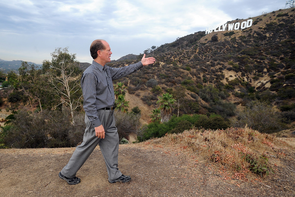 . Chris Baumgart, chairman of the Hollywood Sign Trust, describes the problem with tourists clogging streets and creating fire hazards as they try to access the Hollywood sign in the hills above Hollywood, CA July 10, 2013.  The sign is celebrating its 90th anniversary this year. (Andy Holzman/Los Angeles Daily News)