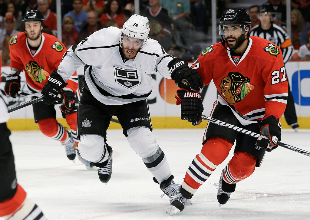 . Los Angeles Kings center Dwight King (74) races up the ice against Chicago Blackhawks defenseman Johnny Oduya (27) during the third period of Game 1 of the NHL hockey Stanley Cup Western Conference finals, Saturday, June 1, 2013, in Chicago. (AP Photo/Nam Y. Huh)
