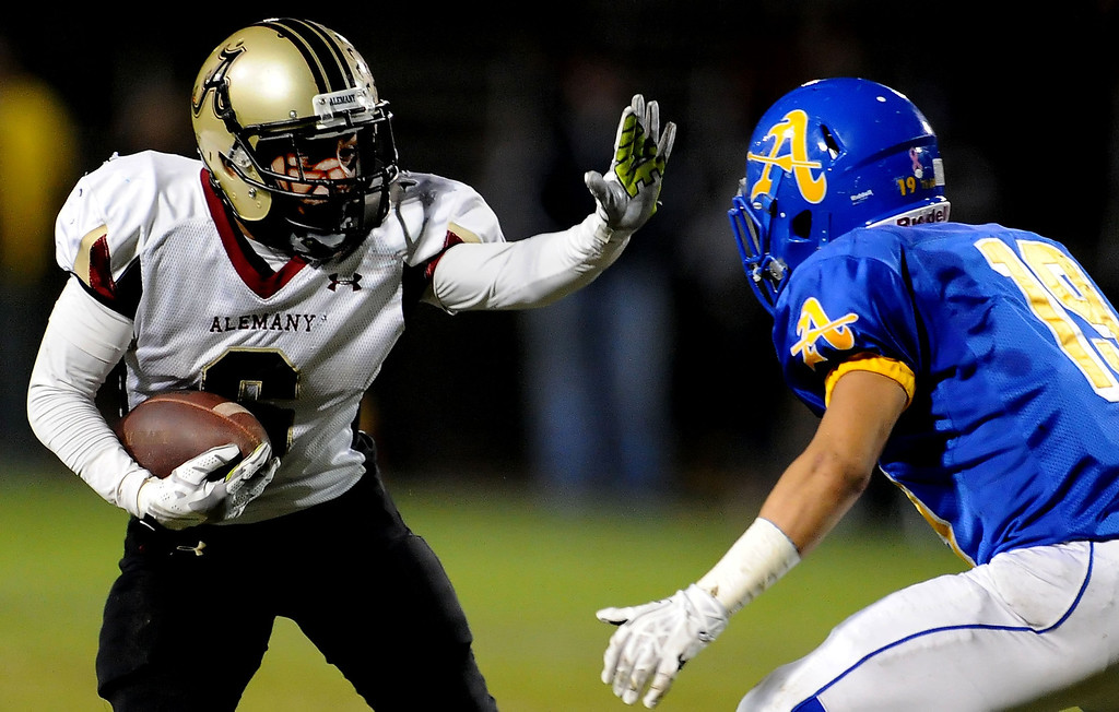 . Alemany\'s Dominic Bush (6) catches a pass in from of Bishop Amat\'s Adrian Ortega (19) for a 20 yard touchdown run in the first half of a prep football game at Bishop Amat High School in La Puente, Calif., on Friday, Oct. 25, 2013.    (Keith Birmingham Pasadena Star-News)