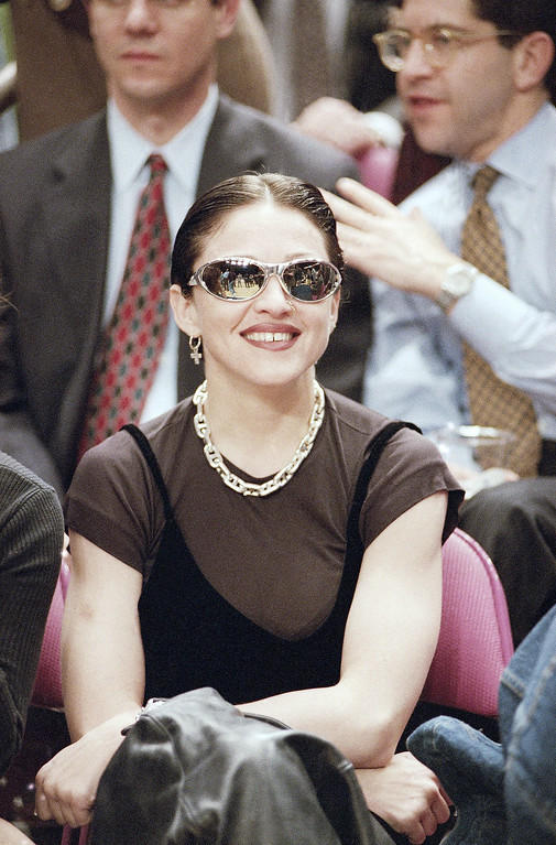 . Entertainer Madonna, watches the Chicago Bulls play the New York Knicks, Tuesday, March 22, 1994 in New York\'s Square Garden.  (AP Photo/Kathy Willens)