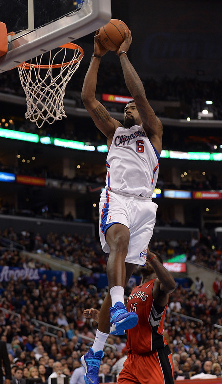 . The Clippers� DeAndre Jordan #6 grabs a lob pass from Matt Barnes #22 for the alley oop dunk as the Raptors� Amir Johnson #15 looks on during their game at the Staples Center in Los Angeles Friday, February 7, 2014. (Photo by Hans Gutknecht/Los Angeles Daily News)