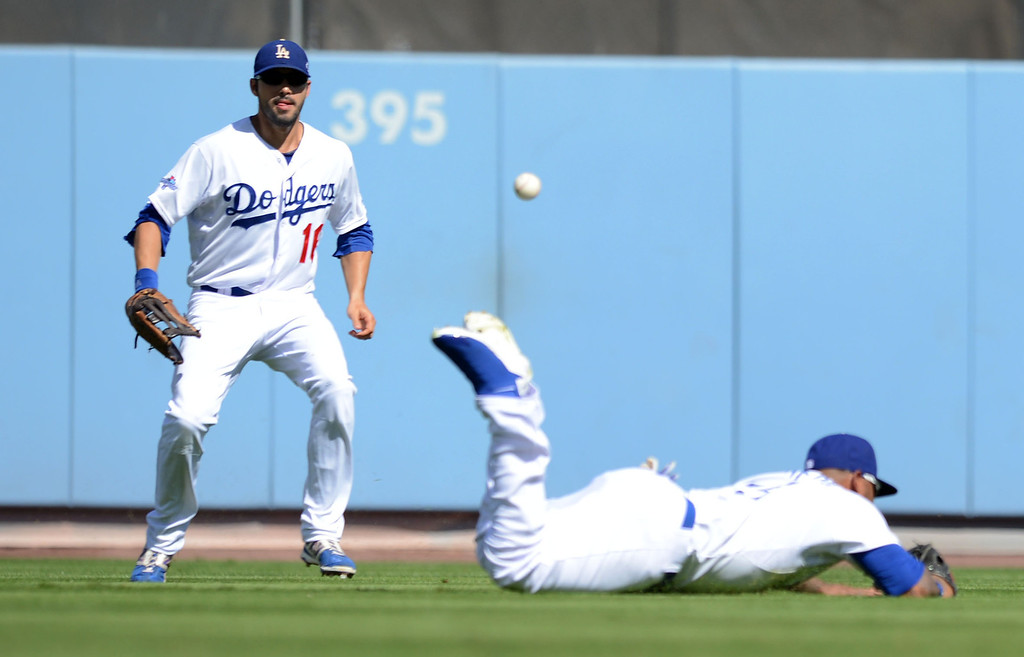 . The Dodgers\' Carl Crawford can\'t make a catch in the first inning against the Cardinals during game 5 of the NLCS at Dodger Stadium Wednesday, October 16, 2013.(David Crane/Los Angeles Daily News)
