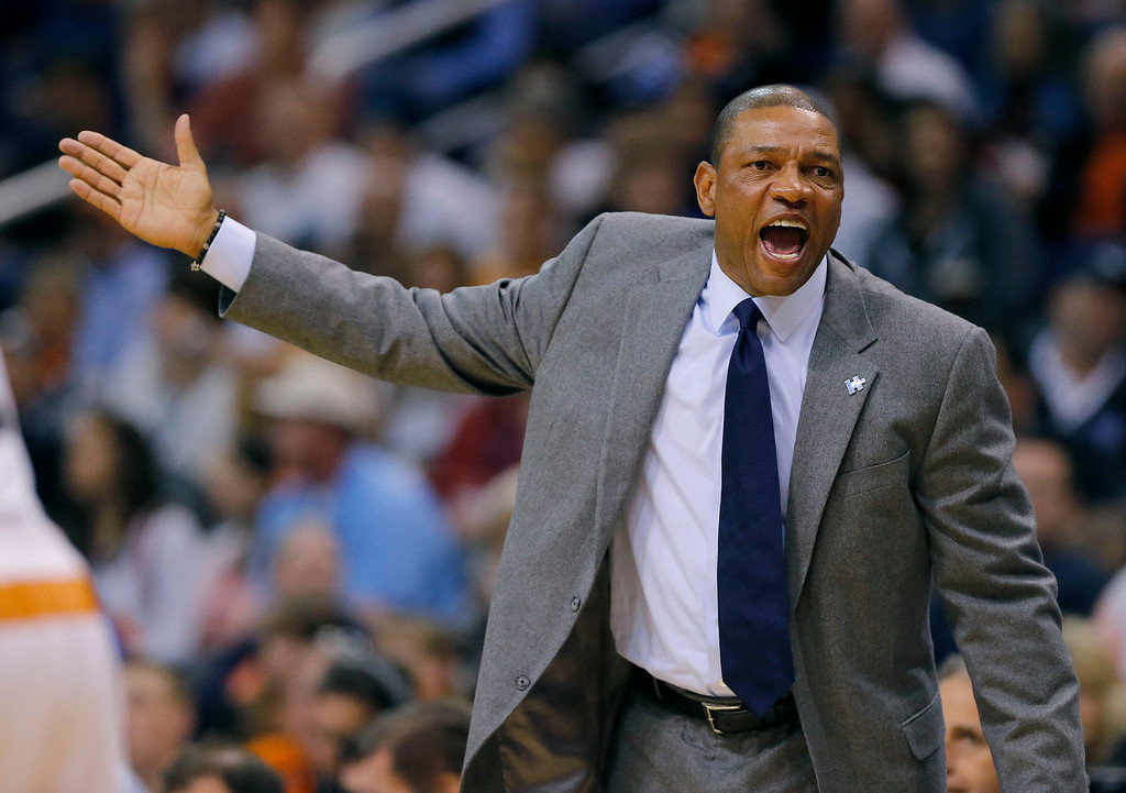 . Los Angeles Clippers head coach Doc Rivers yells to the referee during the first half of an NBA basketball game against the Phoenix Suns, Wednesday, April 2, 2014, in Phoenix. (AP Photo/Matt York)