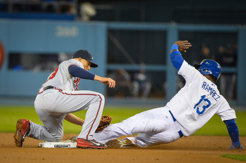 . Dodger\'s Hanley Ramirez is safe at second as the throw to Atlanta\'s Andrelton Simmons can\'t make the tag during game action Monday, October 7, 2013 ( Photo by Andy Holzman/Los Angeles Daily News )