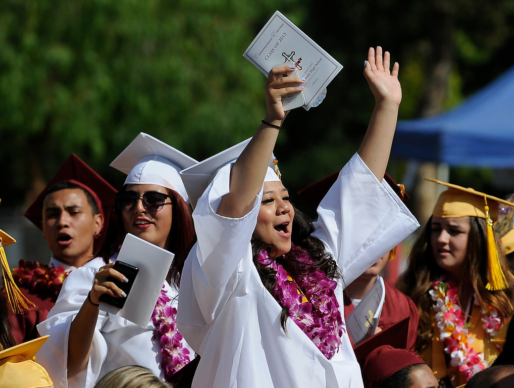 . Students cheer during remarks made by Principal Frank Ferry. The Commencement Exercises for the Bishop Alemany High School Class of 2013 was held at College of the Canyons in Santa Clarita, CA 6/1/2013(John McCoy/LA Daily News)