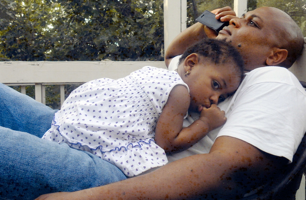 . In this undated family photo, Patrick Sawyer is shown with his daughter Ava at their home in Coon Rapids. Sawyer  died from Ebola after traveling from his native Liberia to Nigeria. (AP Photo)