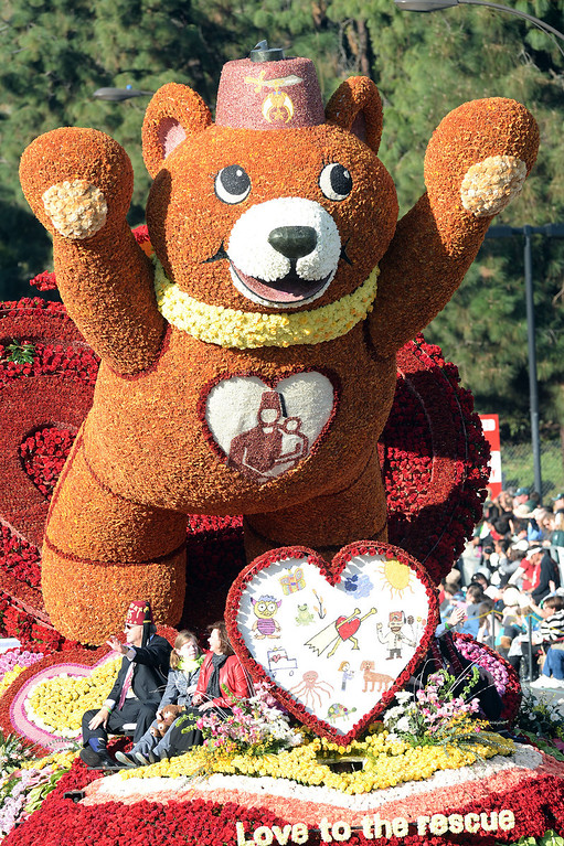 ". The Shrines Hospital for Children ""Love to the Rescue\"" float during the 2014 Rose Parade in Pasadena, CA January 1, 2014.(Keith Durflinger/San Gabriel Valley Tribune)"