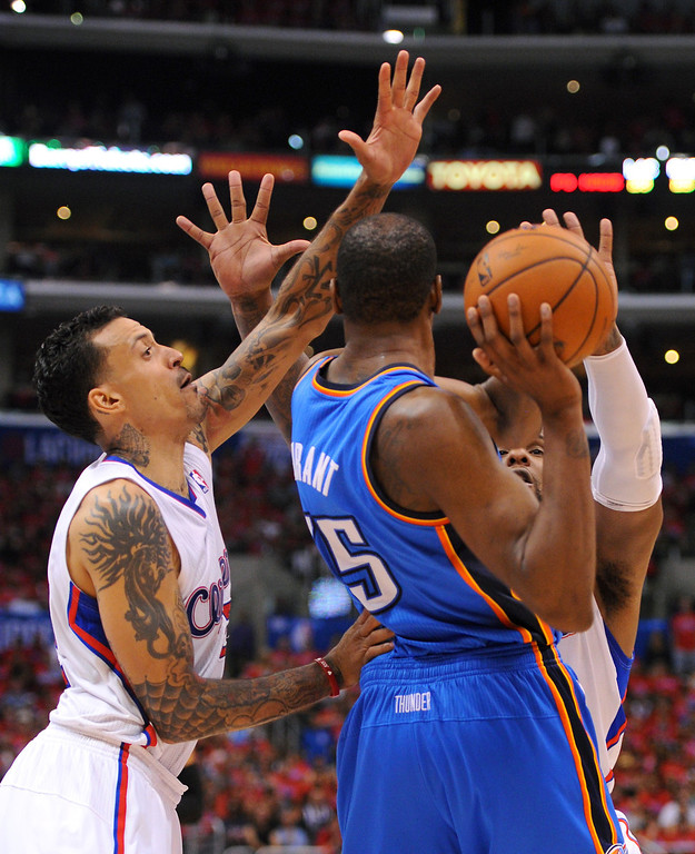 . The Thunder\'s Kevin Durant is double-teamed by the Clippers\' Matt Barnes, left, and Glen Davis, Thursday, May 15, 2014, at Staples Center. (Photo by Michael Owen Baker/Los Angeles Daily News)