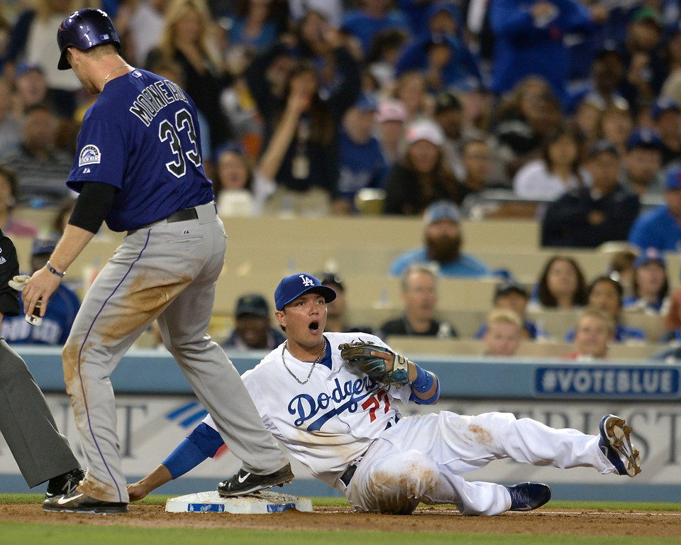 . Dodgers 3rd baseman Miguel Rojas reacts to Rockies #33 Justin Morneau beating the throw in the 6thg inning. The Dodgers defeated the Colorado Rockies at 4-2 Dodger Stadium in Los Angeles, CA. 6/18/2014(Photo by John McCoy Daily News)