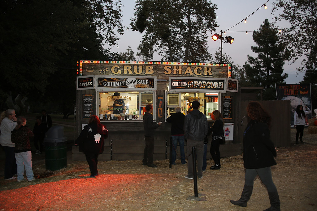 . The Grub Shack at the 5th Annual Los Angeles Haunted Hayride Premiere Night on October 10, 2013.  The fifth year anniversary of the Los Angeles Haunted Hayride took Hayriders through scenes of actual hauntings.  The month-long event will once again take place in Griffith Park�s Old Zoo area, which has been home to murder, torture, paranormal activity, serial killers, and abduction. (Photos by Boris Issaei for the Los Angeles Daily News)