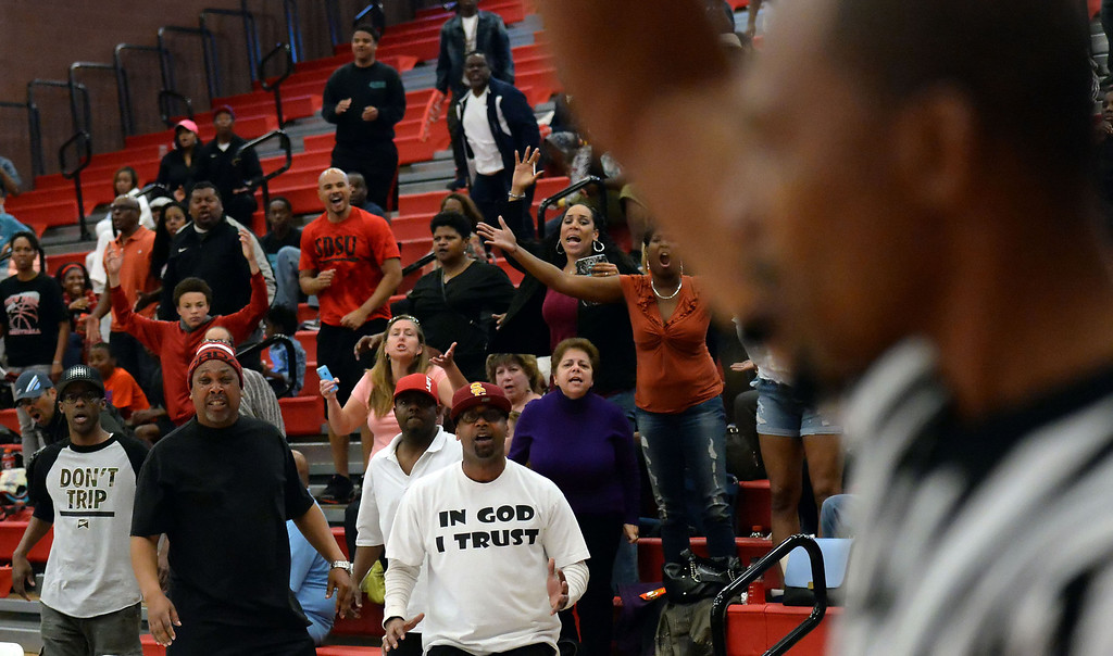 . View Park fans react after Renaissance Academy \'s Marquise Mosley (C) (not pictured) shoots the game winning three point shot in the second half of a CIF Southern California Regional Division basketball game at Colony High School in Ontario, Calif., on Saturday, March 22, 2014. Renaissance Academy won 58-55.  (Keith Birmingham Pasadena Star-News)