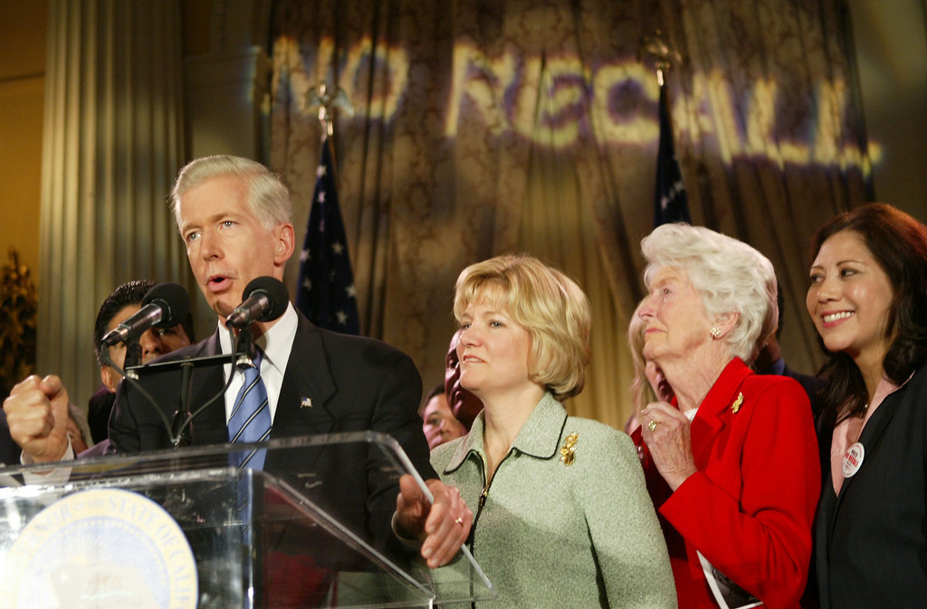 . LOS ANGELES - OCTOBER 7:   (L-R)  California Governor Gray Davis, wife Sharon Davis, Davis\' mother Doris Morrell  and Congresswoman Hilda Solis react during his concession speech to supporters after learning he had lost the California gubernatorial recall election to actor Arnold Schwarzenegger at the Millennium Biltmore Hotel in the Crystal Ballroom, October 7, 2003 in Los Angeles, California.  (Photo by David McNew/Getty Images)