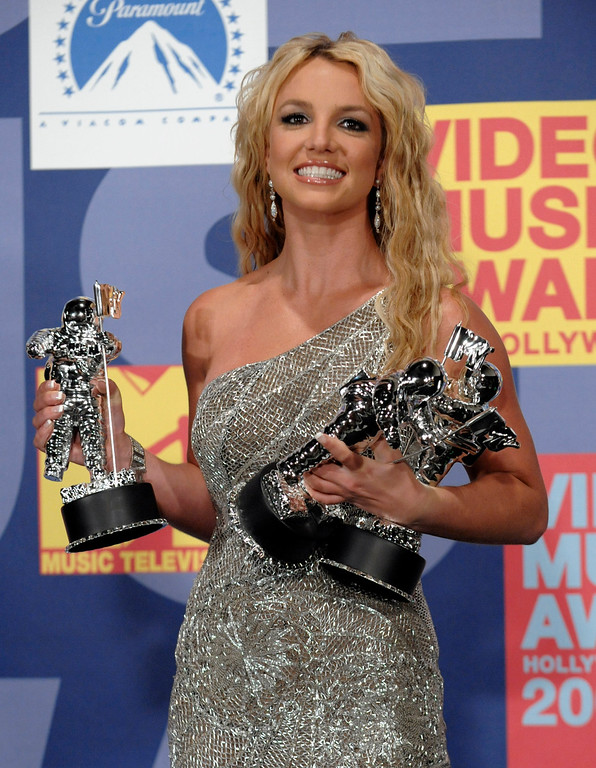 . Britney Spears poses with her awards backstage at the 2008 MTV Video Music Awards held at Paramount Pictures Studio Lot on Sunday, Sept. 7, 2008, in Los Angeles. (AP Photo/Chris Pizzello)
