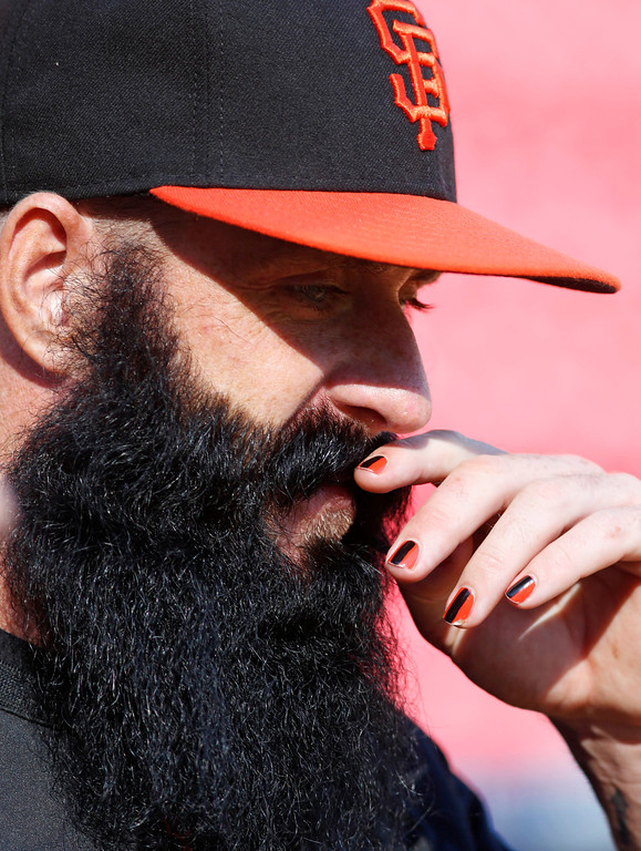 . San Francisco Giants pitcher Brian Wilson watches batting practice prior to Game 3 of the National League division baseball series between the Giants and the Cincinnati Reds, Tuesday, Oct. 9, 2012, in Cincinnati. (AP Photo/David Kohl)