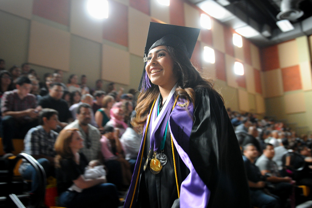 . Students enter the gymnasium during the processional of the graduation at the Cesar Chavez Learning Academies Social Justice Humanitas Academy in San Fernando, Wednesday, June 5, 2013. (Michael Owen Baker/Staff Photographer)