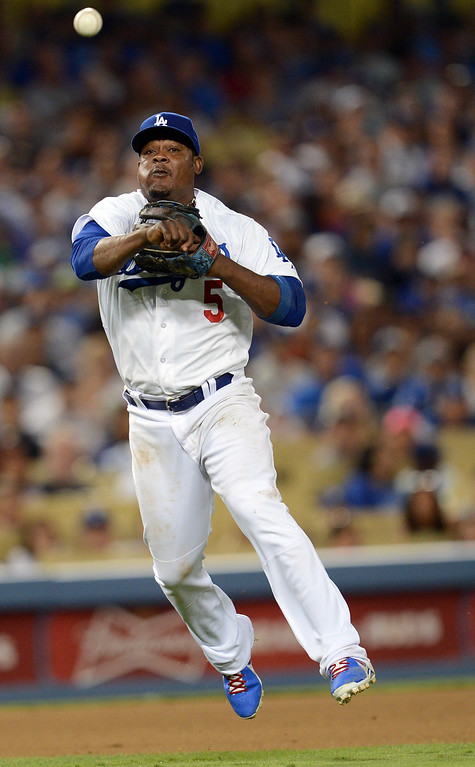 . The Dodgers\' Juan Uribe #5 throws to first base during their game against the Giants at Dodgers Stadium Saturday, September 14, 2013. (Photo by Hans Gutknecht/Los Angeles Daily News)