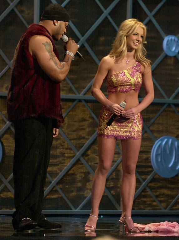 . Show hosts Britney Spears, right, and LL Cool J are seen during the opening of the 28th Annual American Music Awards in Los Angeles, Monday, Jan. 8, 2001. (AP Photo/Michael Caulfield)