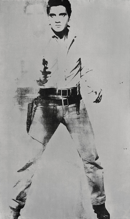. This undated file image provided by Sotheby\'s Auction House shows Andy Warhol\'s portrait of Elvis Presley depicted as a cowboy. The painting, with a silver background, �Double Elvis [Ferus Type]� sold at auction by Sotheby�s in New York for $37 million on May 9, 2012. (AP Photo/Sotheby\'s Auction House, File)