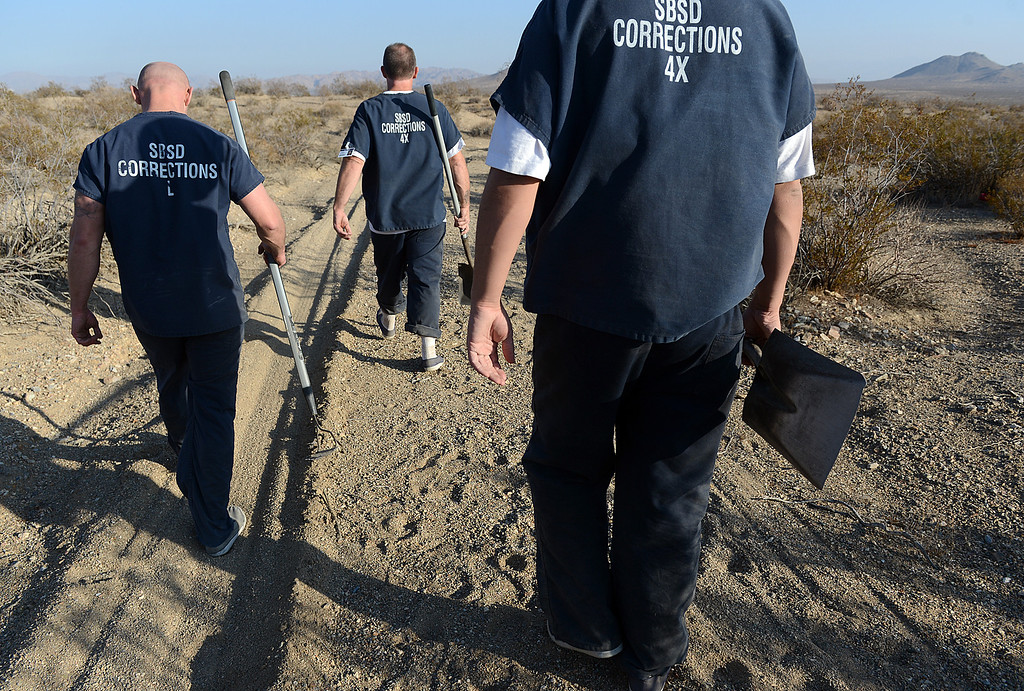 . An inmate work crew from the Adelanto Detention Center fill in the graves following a 30 hour excavation that yielded the remains of Joseph McStay, 40, his wife, Summer, 43, as well as two other remains yet to be identified. The McStays and their two sons, Gianni, 4, and Joseph, 3, vanished from their Fallbrook home about 45 miles north of San Diego in February 2010.  (Photo by Rick Sforza/The Sun)