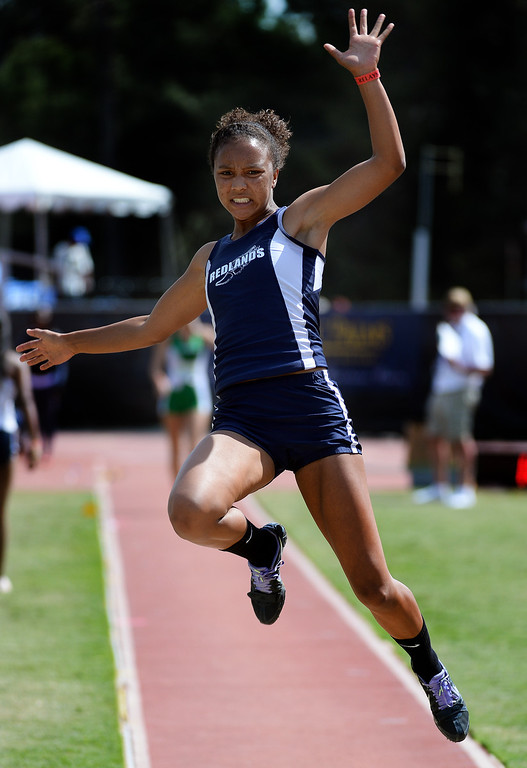 . Redlands\' Margaux Jones competes in the long jump Invitational during the Mt. SAC Relays in Hilmer Lodge Stadium on the campus of Mt. San Antonio College in Walnut, Calif., on Saturday, April 19, 2014. 